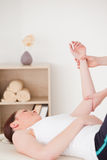 Portrait of a young woman having an arm massage Stock Photography