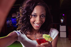 Portrait of young woman having a cocktail Royalty Free Stock Photos