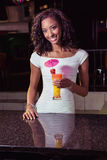 Portrait of young woman having a cocktail at bar counter Royalty Free Stock Photography