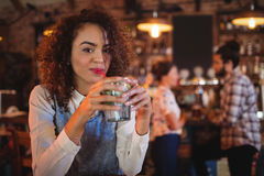 Portrait of young woman having a cocktail drink Stock Photo
