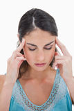 Portrait of a young woman having a headache Stock Images