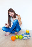 Portrait of a young woman with headphones and green apple listen Royalty Free Stock Image