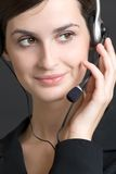 Portrait of young woman with headset, smiling. Close-up portrait of young woman with headset, smiling Stock Photos