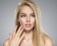 Young Woman with healthy skin of a face. Portrait of  Young Woman with healthy skin of a face. Attractive female with long light straight  hairs and brown make Stock Images