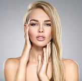 Young Woman with healthy skin of a face. Portrait of  Young Woman with healthy skin of a face. Attractive female with long light straight  hairs and brown make Royalty Free Stock Photo