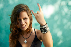 Portrait of young woman in heavy metal style Royalty Free Stock Images