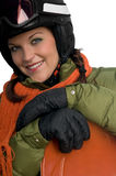 Portrait of young woman with helmet and snowboard Royalty Free Stock Image