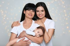Portrait of young woman, her baby and mature mother stock photo