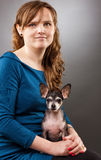 Portrait of a young woman with her chihuahua Royalty Free Stock Images