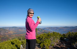 Portrait of young woman hiker with cup of tea Royalty Free Stock Image