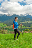 Portrait of young woman hiking with beautiful mountain scenery on background Stock Photos
