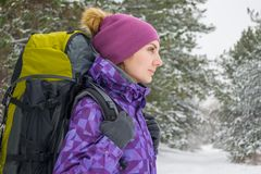 Woman Hiking with Big Backpack in Beautiful Winter Forest Royalty Free Stock Image