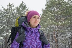 Woman Hiking with Big Backpack in Beautiful Winter Forest Royalty Free Stock Images