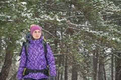 Woman Hiking with Big Backpack in Beautiful Winter Forest Royalty Free Stock Photo