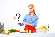 Portrait of a young woman, hold question mark Stock Images