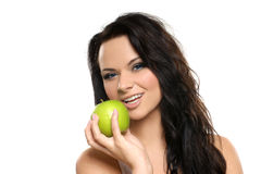 Portrait of a young woman holding an apple Stock Photos