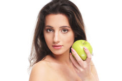 Portrait of a young woman holding an apple Royalty Free Stock Photography