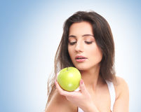 Portrait of a young woman holding an apple Stock Images