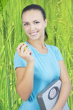 Portrait of young woman holding apple and weght Stock Images