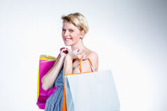 Portrait of a young woman holding bags Stock Photography