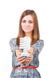Portrait Of A Young Woman Holding Bulb Royalty Free Stock Photos