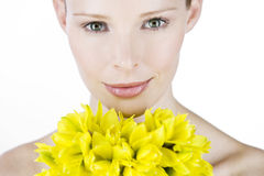 A portrait of a young woman holding a bunch of daffodils Stock Photos
