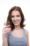 Portrait of a young woman holding chocolate bar Stock Photos
