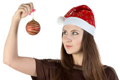 Portrait of young woman holding christmas ball Stock Photo