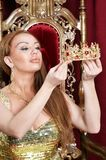 Young woman holding crown. Queen Royalty Free Stock Images