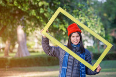 Portrait of Young Woman holding frame Stock Images