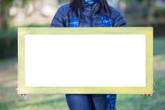 Portrait of Young Woman holding frame Royalty Free Stock Images