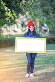 Portrait of Young Woman holding frame Royalty Free Stock Photo
