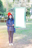 Portrait of Young Woman holding frame Royalty Free Stock Image
