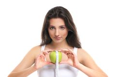 Portrait of a young woman holding a fresh apple Royalty Free Stock Photography