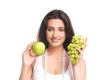 Portrait of a young woman holding fruits Stock Photos