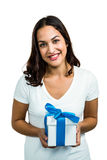 Portrait of young woman holding gift box Stock Photos