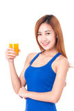 Portrait of young woman holding glass of orange juice Stock Photos
