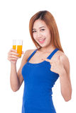 Portrait of young woman holding glass of orange juice Royalty Free Stock Photos