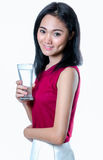 Portrait of young woman holding glass of water. On white  background Royalty Free Stock Photos