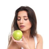 Portrait of a young woman holding a green apple Royalty Free Stock Photography