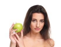 Portrait of a young woman holding a green apple Royalty Free Stock Images