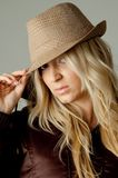 Portrait of young woman holding hat Royalty Free Stock Image