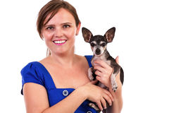 Portrait of a young woman holding her dog. Portrait of a young woman holding her chihuahua dog isolated on white background Stock Photo