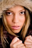 Portrait of young woman holding her winter coat Royalty Free Stock Image