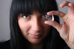 Portrait of young woman holding ice cube Royalty Free Stock Image