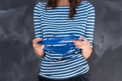 Woman holding a internet cable in front of chalk drawing board Stock Image
