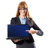 Portrait of a young woman holding a laptop and displaying a blank screen Royalty Free Stock Photography