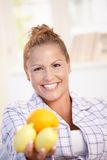 Portrait of young woman holding lemons in hand Royalty Free Stock Images