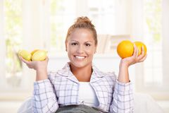 Portrait of young woman holding lemons in hands Royalty Free Stock Photography