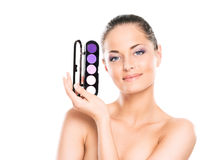 Portrait of a young woman holding a makeup pallette Stock Photo